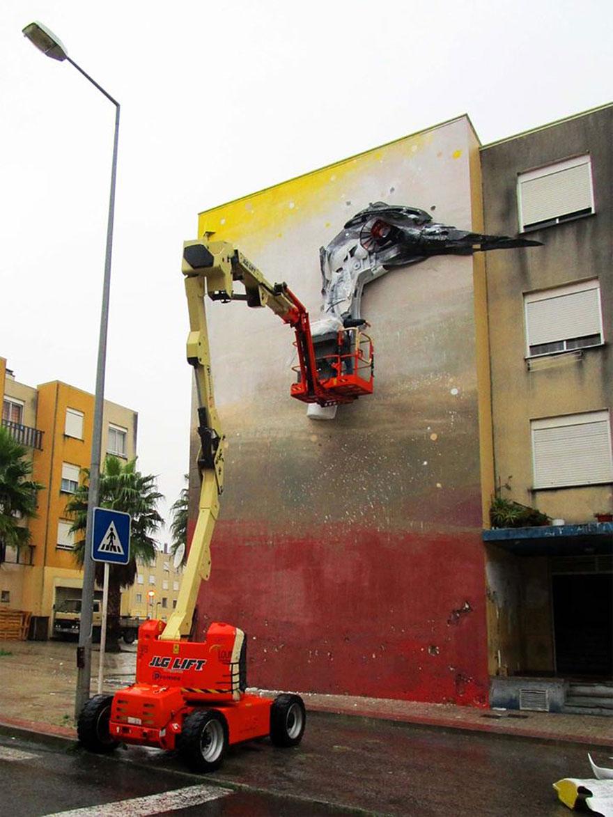 swan street art by bordalo