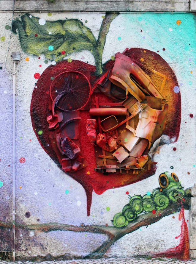 apple street art by bordalo