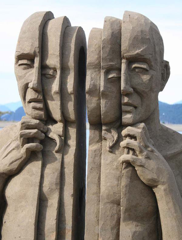 man spilted sand sculptures by carl jara