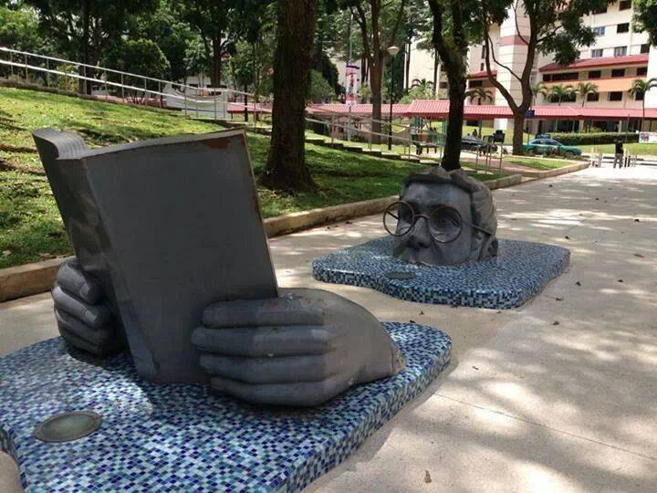 man book reading sculpture