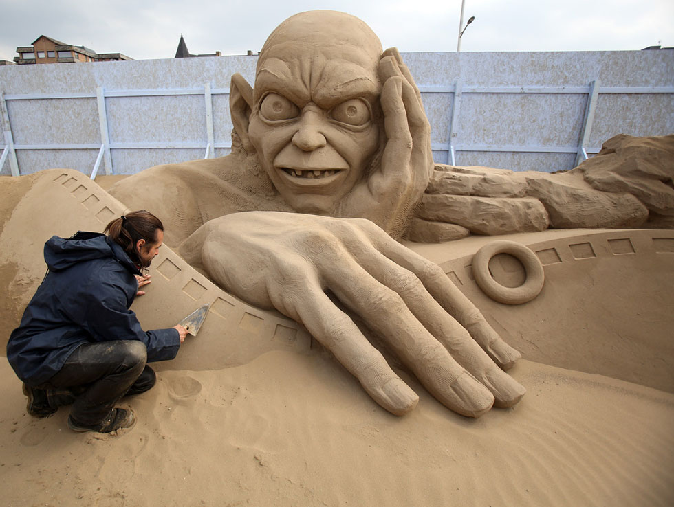 man sand sculptures