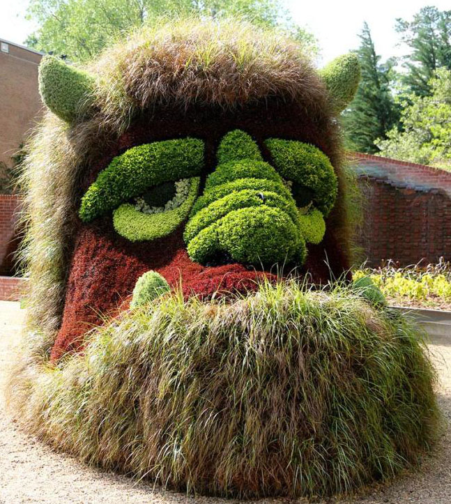 4 cartoon man garden sculptures