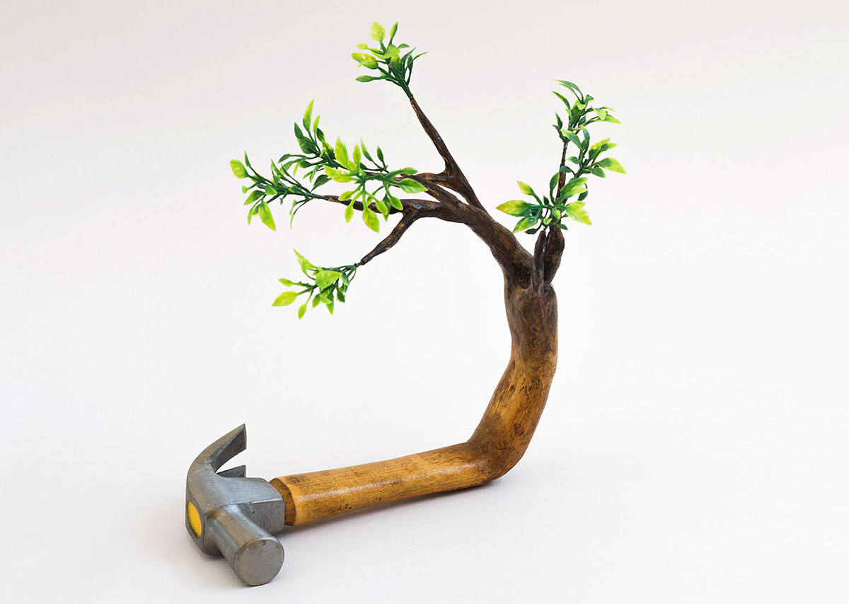 creative wood sculpture hammer by camille kachani