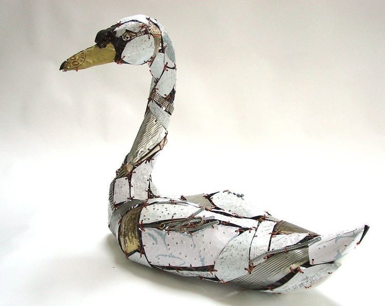 sculpture recycled material white swan by barbara franc