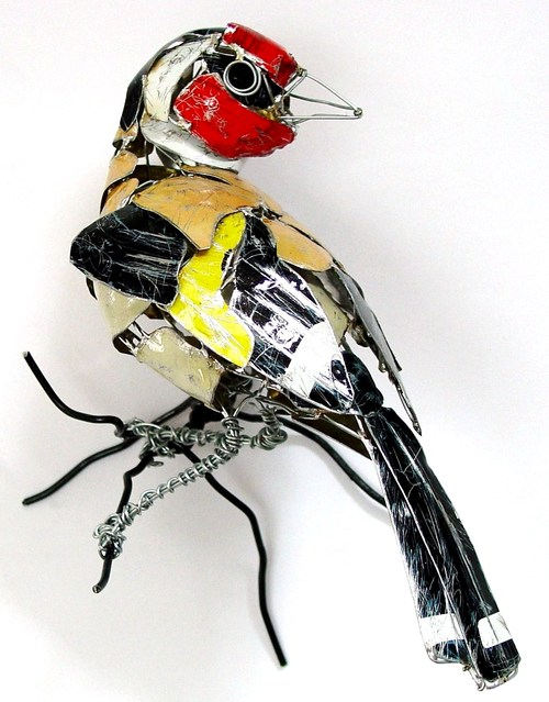 sculpture recycled material goldfinch by barbara franc