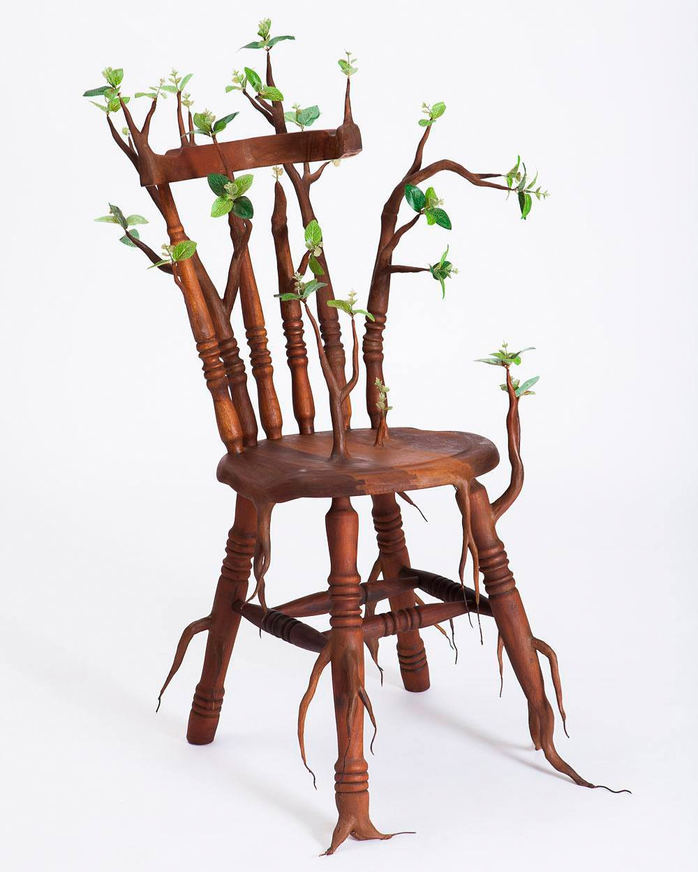 funny wood sculpture by chair camille kachani