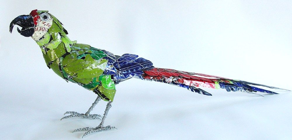 sculpture recycled material military macaw by barbara franc