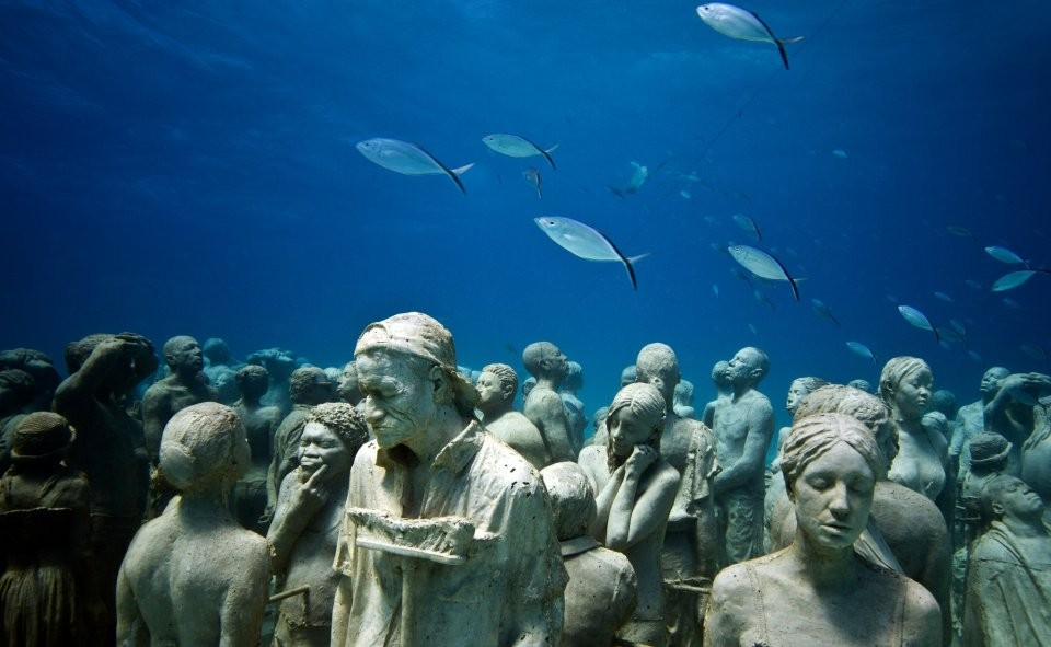 3 people underwater sculptures by taylor