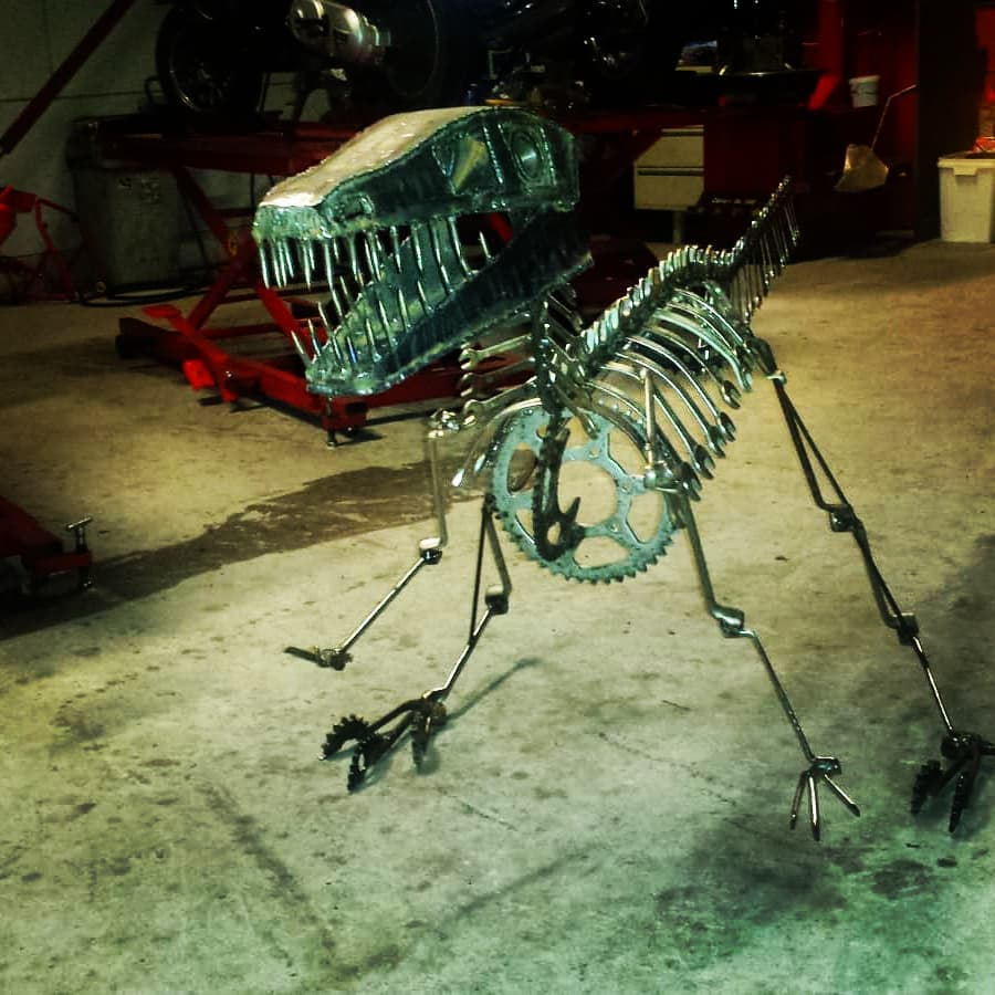 scrap metal sculpture dino jos hammers