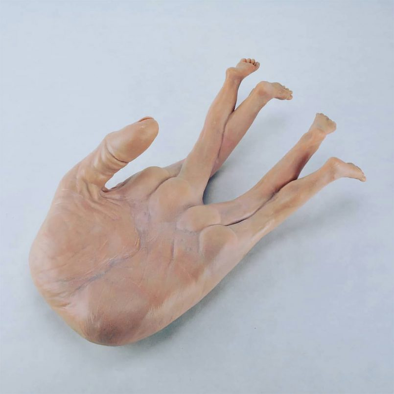 distorted human sculpture fingers by alessandro boezio