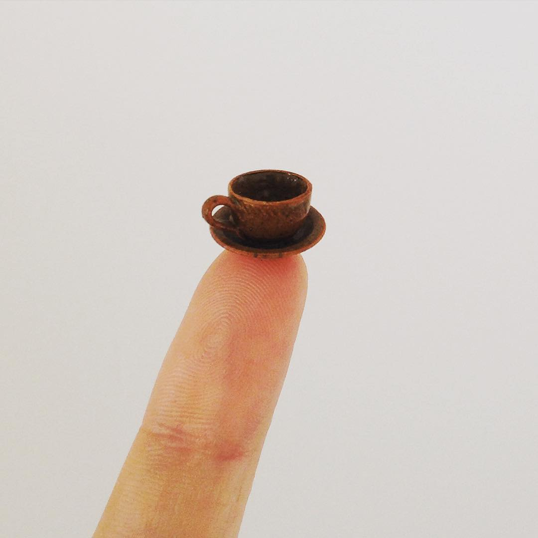 3 tea cup miniature sculptures