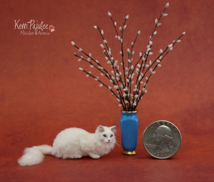 white cat miniature animal sculpture by kerri pajutee