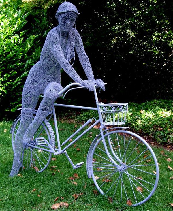 1 wire sculpture lady bike by derek kinzett