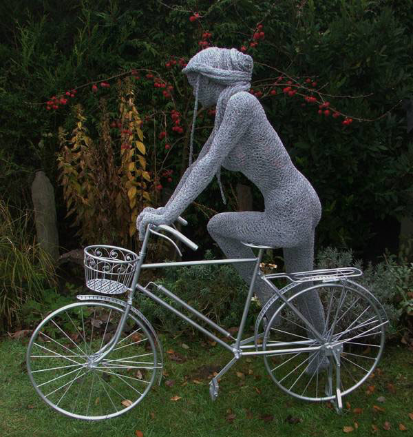 wire sculpture lady bike by derek kinzett