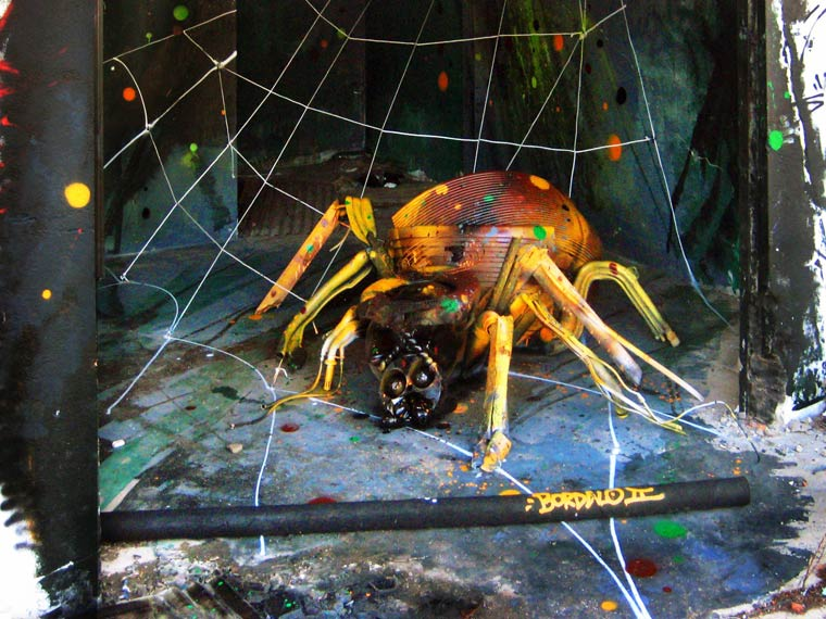 spider street art by bordalo