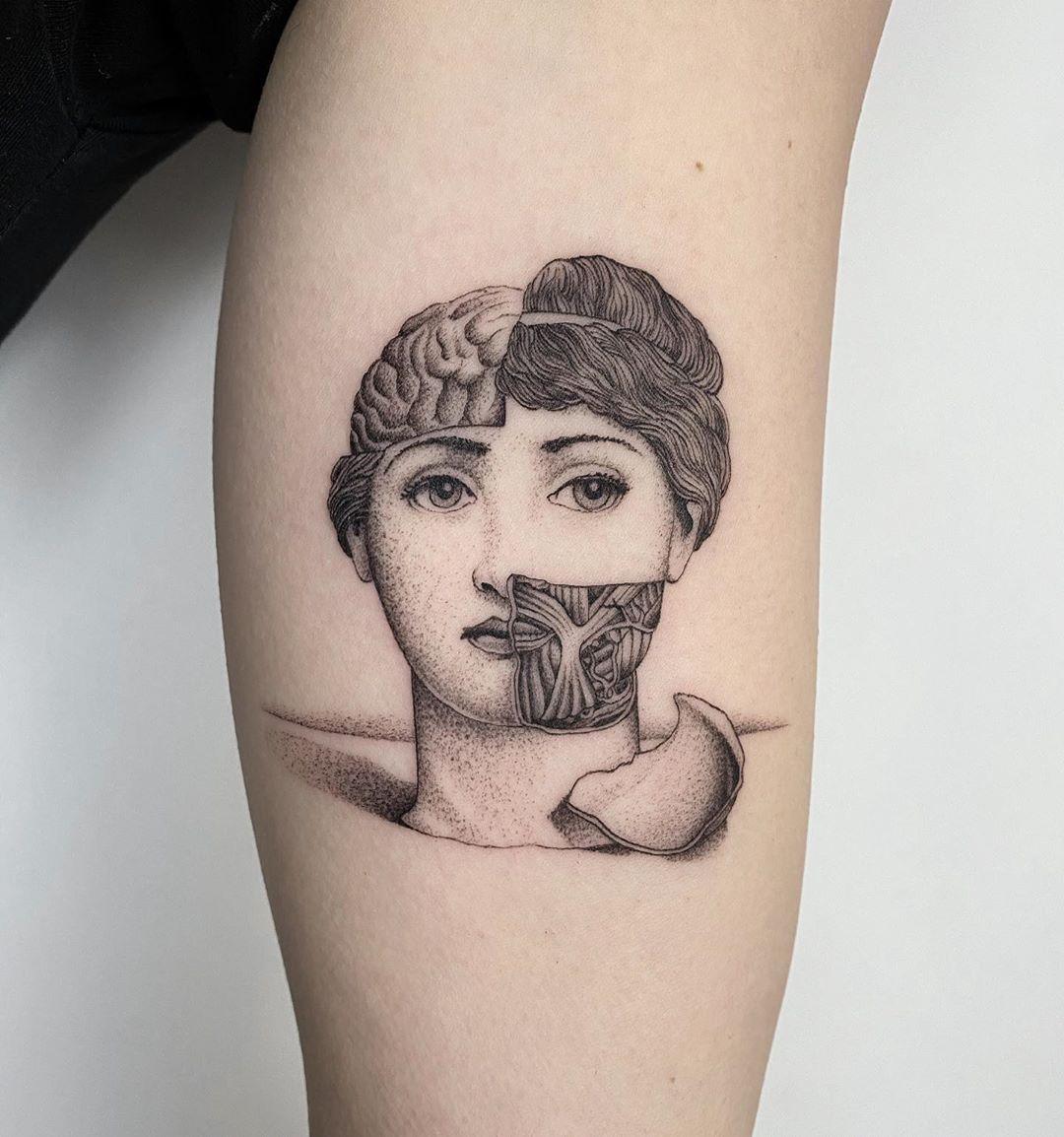 tattoo dot work broken face michele volpi