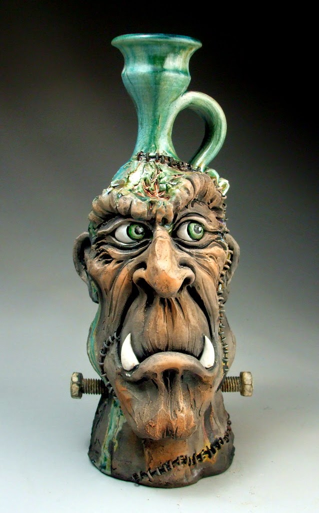 ceramic sculpture monster face by mitchell grafton