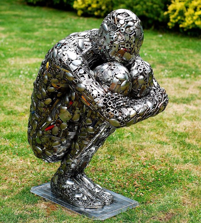 scrap sculpture sad man by brian mock