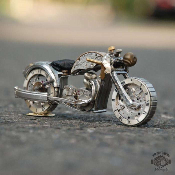 scrap sculpture old watch bike by dan tanenbaum