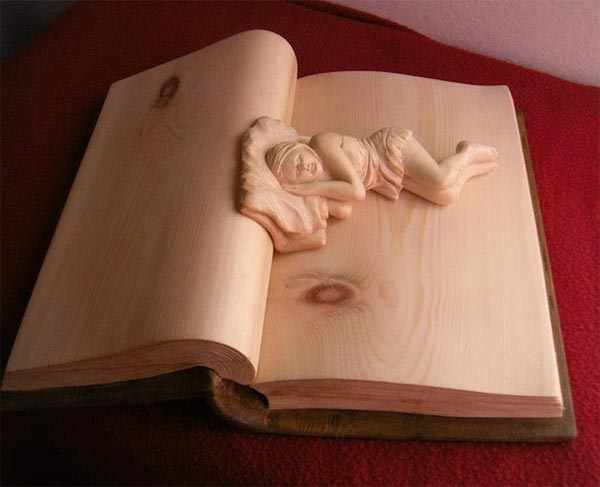 wood carving lady lying
