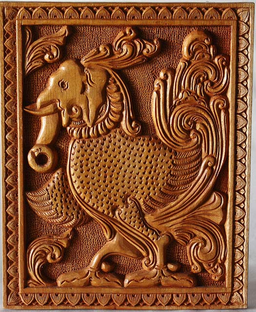 wood carving surreal bird and elephant