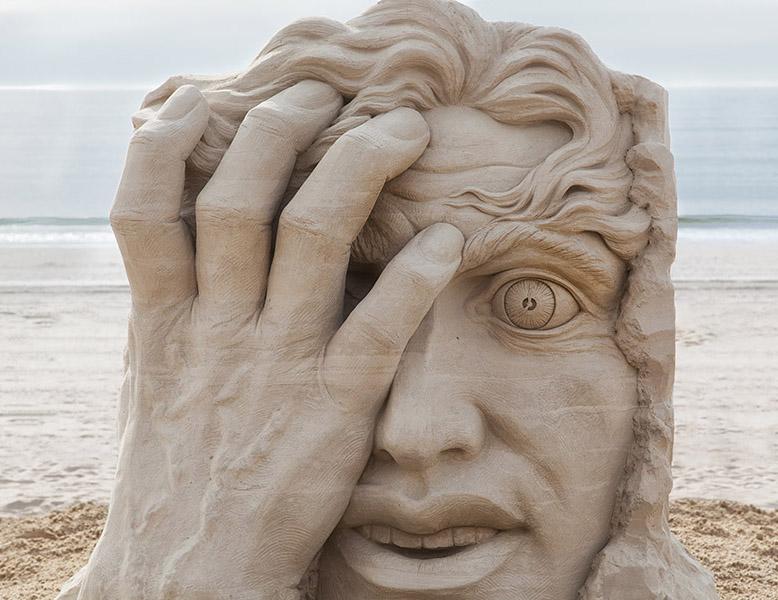 16 hand sand sculptures