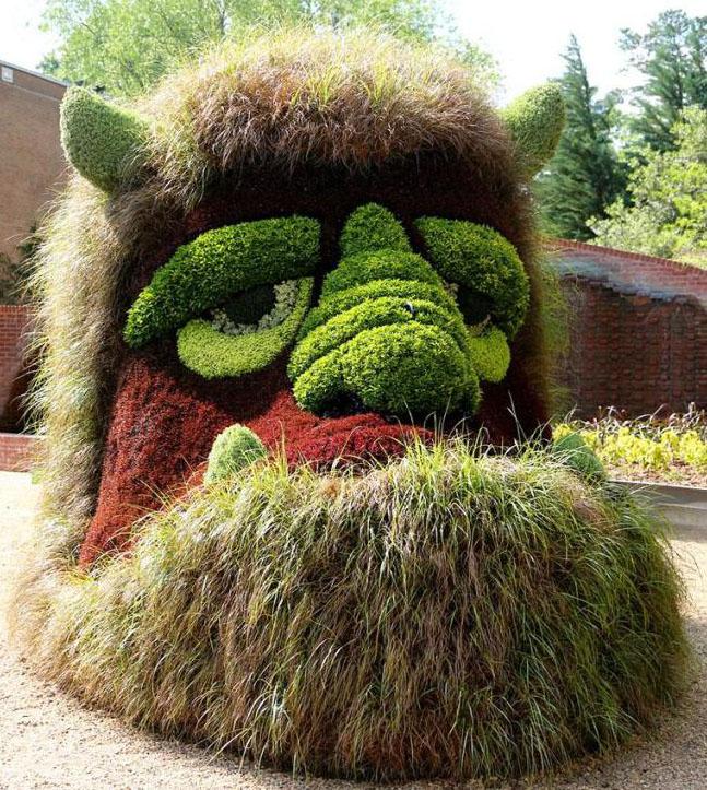 4 cartoon man garden sculptures