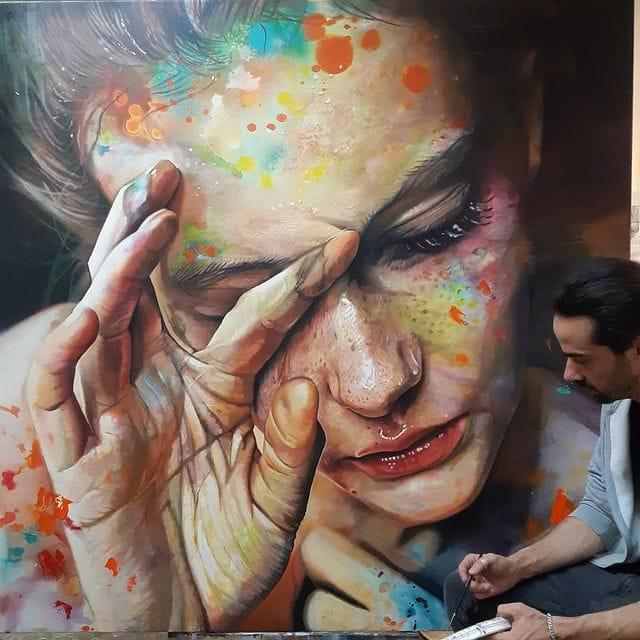 mural portrait painting woman sad