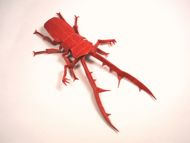 9 cyclommatus metalifer paper sculptures art
